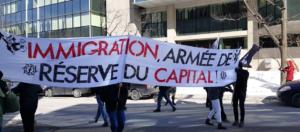 Bannière portée par Atalante le 4 mars 2017, à Québec.